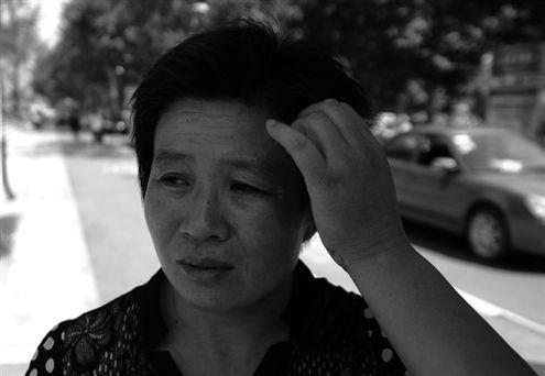 孩子失踪,张女士心急如焚 记者刘畅摄