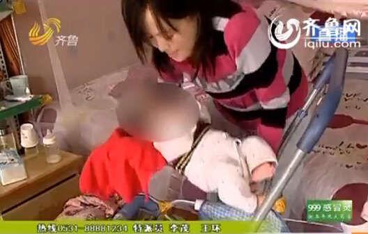 患有急性白血病的陈娟肚子照顾4个月大的女儿(视频截图)